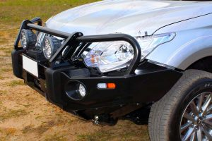 Closeup view of an Ironman 4x4 Deluxe Commercial Black Bullbar fitted to a Triton