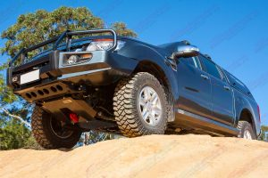 Front left underside view of the PX Ford Ranger fitted with a heavy duty superior engine guard, rated recovery point and rock sliders