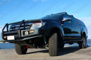 Front left view of a Dark Grey Ford Ranger dual cab fitted with superior upper control arms, rock sliders, diff guard, bash plate, recovery point and transfer case guard