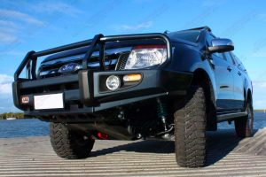 Under side view of a Dark Grey Ford Ranger dual cab fitted with superior upper control arms, rock sliders, diff guard, bash plate, recovery point and transfer case guard