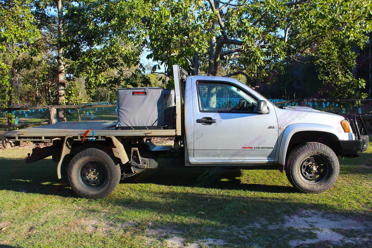 Right side view of a Silver RC Holden Colorado single cab fitted with a 45mm Tough Dog lift kit