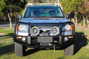 Front closeup view of a Silver RC Holden Colorado single cab fitted with an Ironman 4x4 bullbar, winch, light bar and spotlights