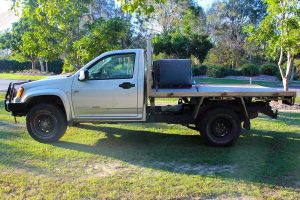 Left side view of a Silver RC Holden Colorado single cab fitted with a 45mm Tough Dog lift kit