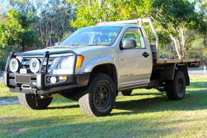 Front left view of a Silver RC Holden Colorado single cab fitted with an 45mm Tough Dog lift kit, Ironman 4x4 bullbar, winch, light bar and spotlights