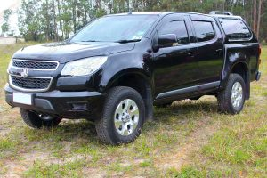 """Front left angle view of a Black RG Holden Colorado dual cab fitted with an Ironman 4x4 2"""" Inch Lift Kit"""