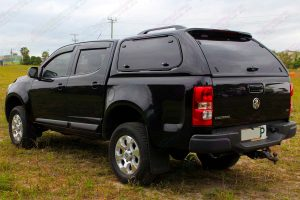 """Rear left end view of a Black RG Holden Colorado dual cab fitted with an Ironman 4x4 2"""" Inch Lift Kit"""