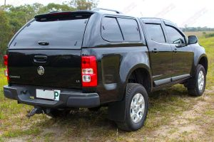 """Rear right end view of a Black RG Holden Colorado dual cab fitted with an Ironman 4x4 2"""" Inch Lift Kit"""