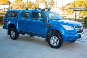 """Front right side view of a blue RG Holden Colorado fitted with the Superior 2"""" lift kit"""