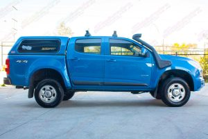 "Right side profile view of a blue RG Holden Colorado fitted with the Superior 2"" lift kit"