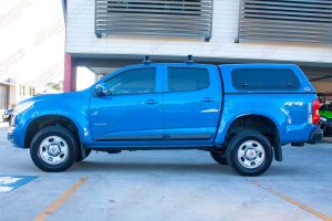 """Left side profile view of a blue RG Holden Colorado fitted with the Superior 2"""" lift kit"""