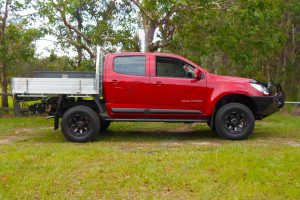 "Right side profile of a Red Holden Colorado RG Dual Cab fitted with a Superior 2"" lift kit, Ironman Bullbar and sidesteps"