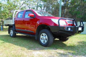 "Right front view of a Red Holden Colorado RG Dual Cab fitted with a Superior 2"" lift kit, Ironman Bullbar and sidesteps"