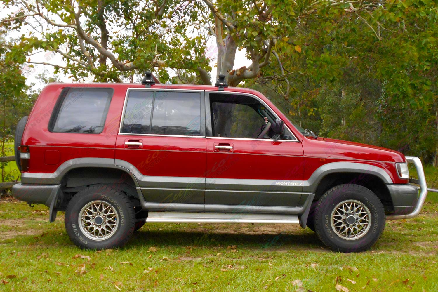 Right side view of a red Holden Jackaroo wagon fitted with a 40mm Ironman 4x4 Performance lift kit