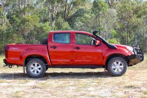 Right side view of a Isuzu D-Max dual cab fitted with a Bullbar, side steps, towbar, snorkel, uhf radio and lightbar