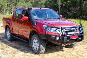 Front right side view of a Isuzu D-Max dual cab ute fitted with a Bullbar, side steps, towbar, snorkel and lightbar