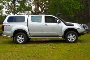 Right side view of a silver Isuzu D-Max dual cab fitted with a 2 inch superior nitro gas lift kit