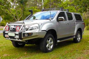 Front left angle view of a silver Isuzu D-Max dual cab fitted with a 2 inch superior nitro gas lift kit