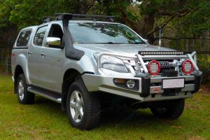 Front right angle view of a silver Isuzu D-Max dual cab fitted with a 2 inch superior nitro gas lift kit