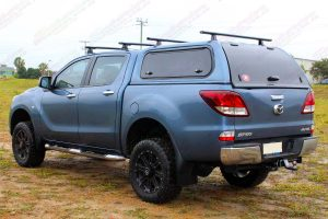 "Left side rear end view of a blue series 2 Mazda BT-50 dual cab fitted with a Superior 2"" inch lift kit"