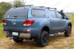"Right side rear end view of a blue series 2 Mazda BT-50 dual cab fitted with a Superior 2"" inch lift kit"