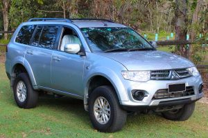 Front right angle view of a grey PB Mitsubishi Challenger wagon 4WD fitted with a premium 30mm Tough Dog lift kit