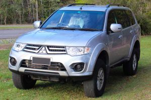 Front left angle view of a grey PB Mitsubishi Challenger wagon 4WD fitted with a premium 30mm Tough Dog lift kit