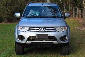 Full front view of a grey PB Mitsubishi Challenger wagon 4WD fitted with a premium grade 30mm Tough Dog lift kit