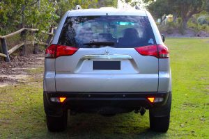 Full rear end view of a grey PB Mitsubishi Challenger wagon 4WD fitted with a premium grade 30mm Tough Dog lift kit