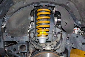 Close up view of a Tough Dog coil spring and front strut fitted to the PB Mitsubishi Challenger four wheel drive