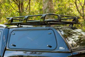 Closeup view of an Ironman 4x4 canopy and roof rack fitted to a NP300 D23 Navara