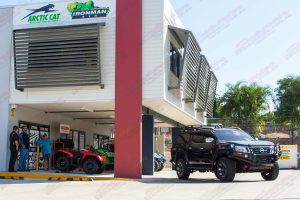 A Black NP300 D23 Navara out the front of the Superior Deception Bay 4x4 retail showroom