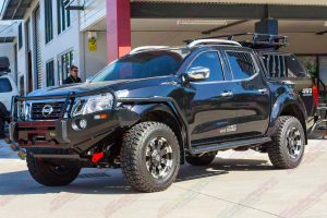 Front left side view of a Black NP300 Nissan Navara dual cab fitted out with a complete range of Ironman 4x4 accessories.