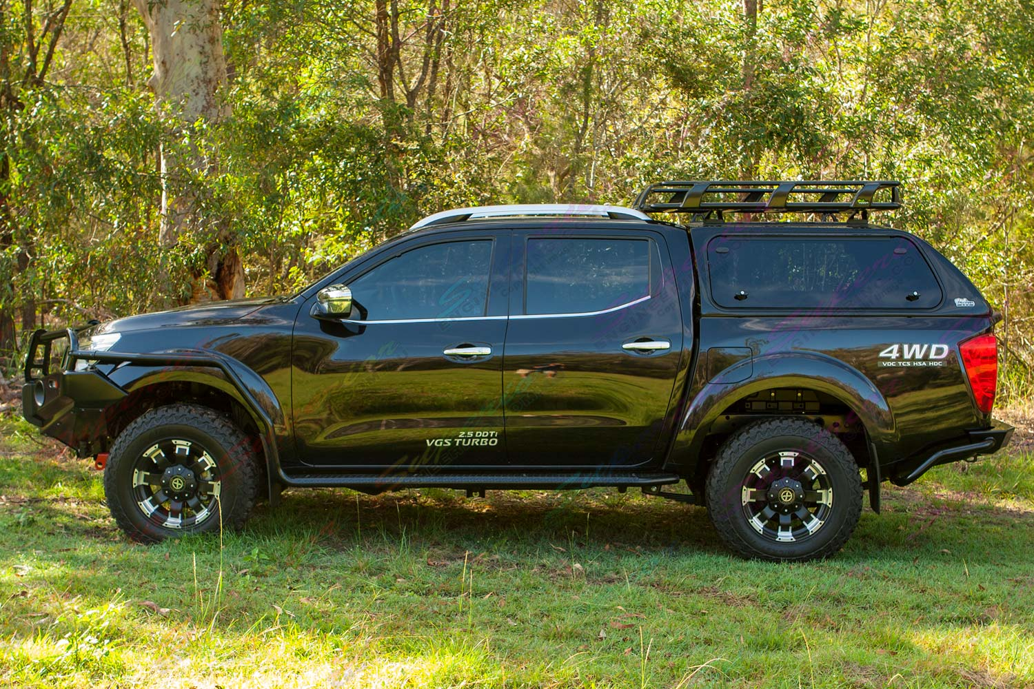 Left side profile view of a Black NP300 Nissan Navara dual cab fitted out with a complete range of Ironman 4x4 accessories.