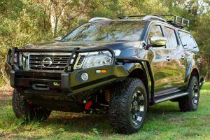 Front view of an Ironman 4x4 bullbar, bash plate, recovery point fitted to a Black NP300 Nissan Navara dual cab