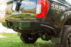 Closeup view of an Ironman 4x4 rearbar fitted to the rear of a Black NP300 Nissan Navara dual cab