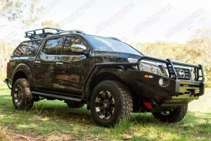 Right side view of an Ironman 4x4 bullbar, bash plate, recovery point, side steps, roof rack and canopy fitted to a Black NP300 Nissan Navara dual cab