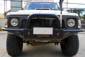 """Full front view of a white GQ Nissan Patrol Shorty fitted with a 3"""" inch Superior Custom built lift kit"""