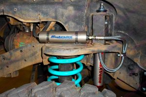 Closeup view of the AmadaXtreme remote res shock mounted to the coil tower on the SWB GQ Nissan Patrol