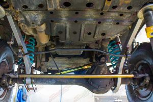 Full underside view of a Superior Tierod, Coil Springs and Superflex Radius Arms fitted to the GQ Nissan Patrol Wagon