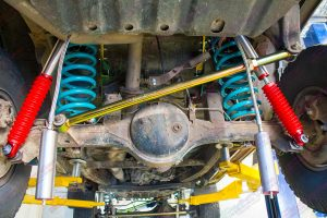 Closeup view of the Superior Panhard rod, coil springs and AmadaXtreme remote res shocks being fitted to the GQ Nissan Patrol. The reservoirs have not been mounted yet.