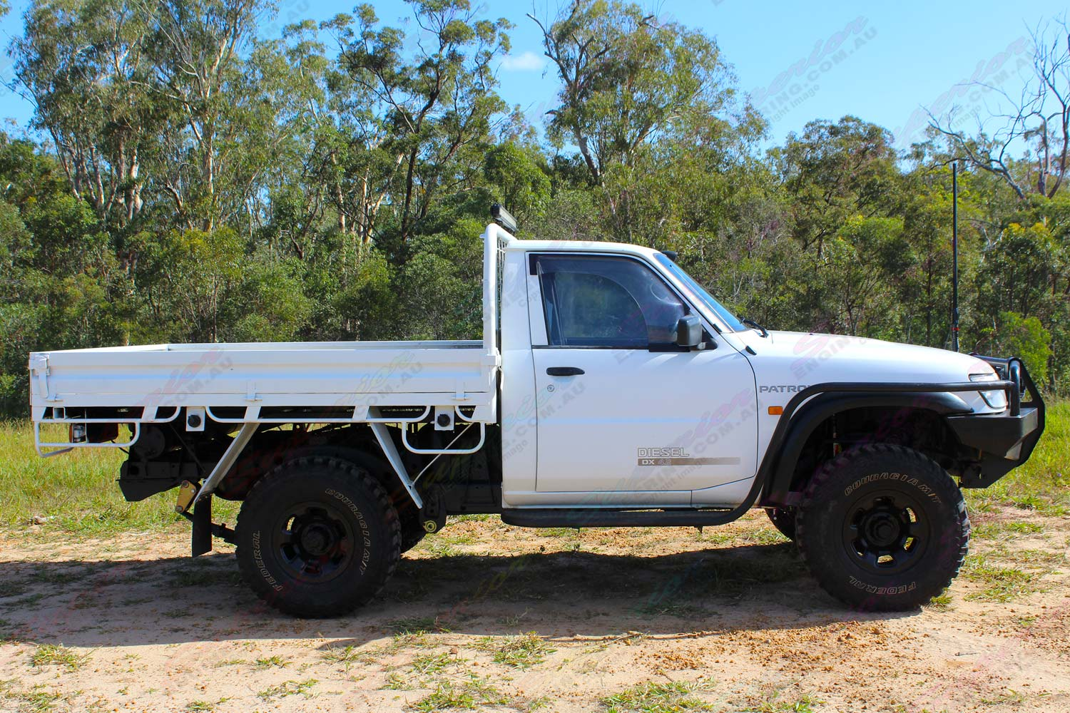 "Right side view of a white GU Nissan Patrol single cab ute fitted with a 4-5"" inch Superior Engineering superflex lift kit"