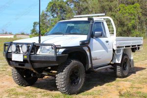 "Front left side view of a white GU Nissan Patrol single cab ute fitted with a 4-5"" inch Superior Engineering superflex lift kit"