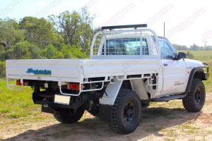"""Rear right side view of a white GU Nissan Patrol (single cab ute) fitted with a 4-5"""" inch Superior Engineering superflex lift kit"""