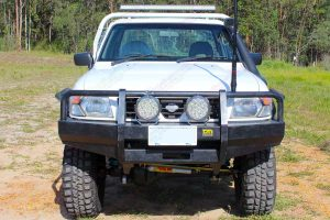 "Full front view of the white GU Nissan Patrol (single cab ute) fitted with a 4-5"" inch Superior Engineering superflex lift kit"