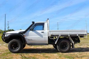 """Left side view of a white GU Nissan Patrol single cab chassis fitted with a 4-5"""" inch Superior Engineering superflex lift kit"""