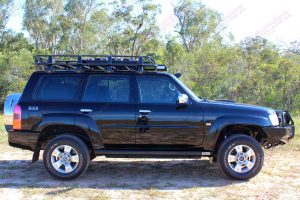"""Right side view of a black GU Nissan Patrol Wagon fitted with a 2"""" lift kit, bullbar, winch, rock sliders, tow points, erps and more"""
