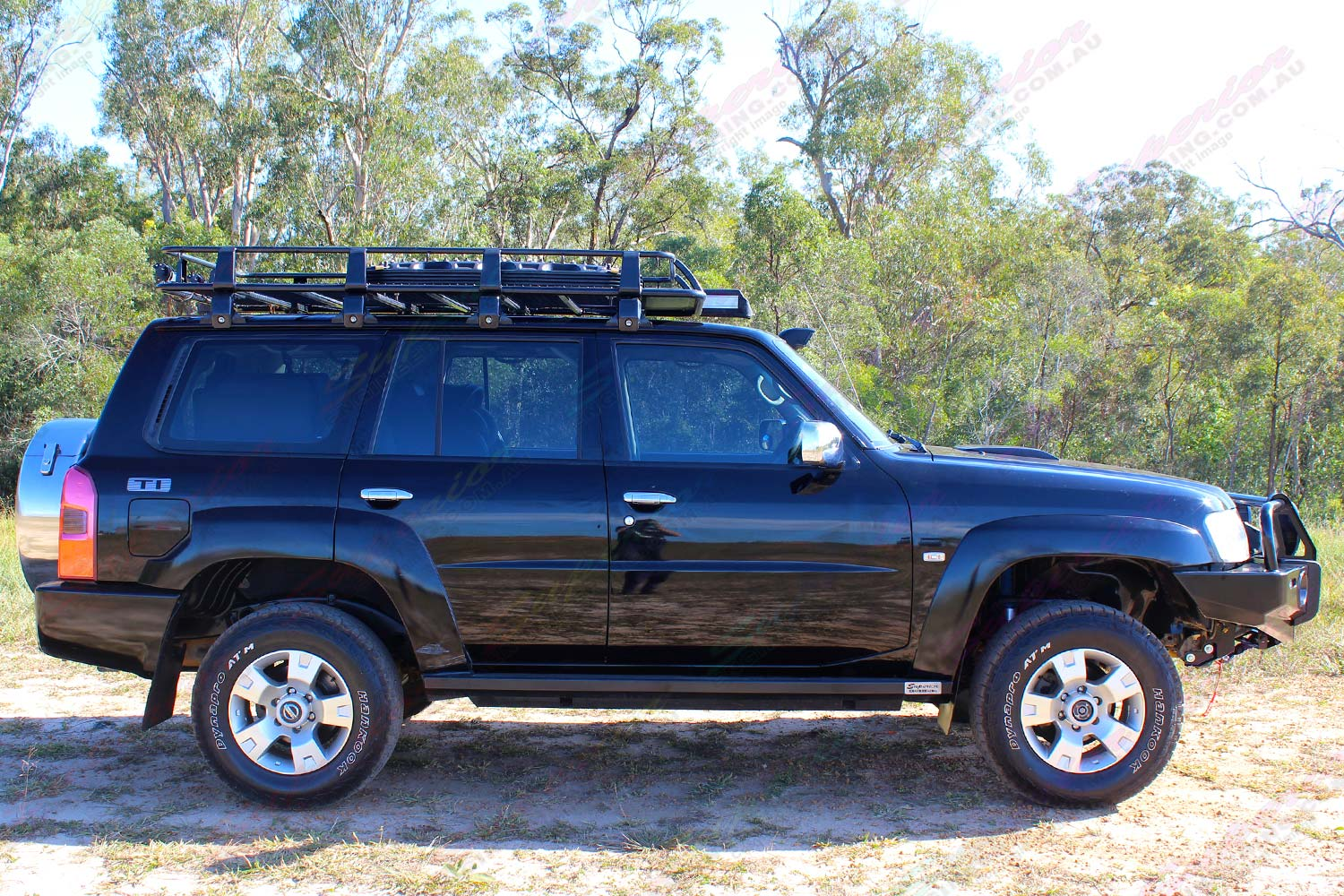 "Right side view of a black GU Nissan Patrol Wagon fitted with a 2"" lift kit, bullbar, winch, rock sliders, tow points, erps and more"