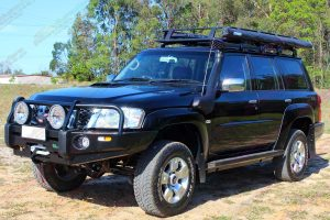 """Left side view of a black GU Nissan Patrol Wagon fitted with a Superior 2"""" lift kit, Ironman bullbar, Warn winch, Stealth rock sliders, tow points, erps and more"""