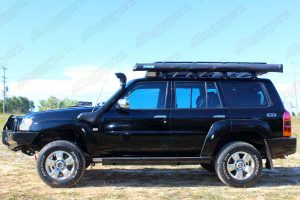 """Left side profile view of the GU Nissan Patrol Wagon fitted with a Superior 2"""" lift kit, Ironman bullbar, Warn winch, Stealth rock sliders, tow points, erps and more"""
