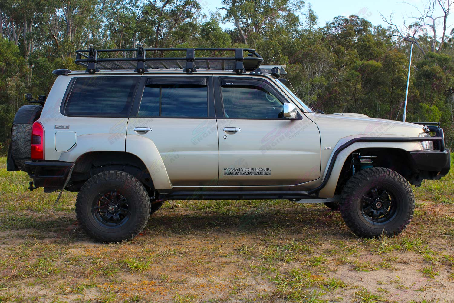 "Right side view of a Gold GU Nissan Patrol Wagon fitted with a 3"" Inch Remote Reservoir Superflex Lift Kit"